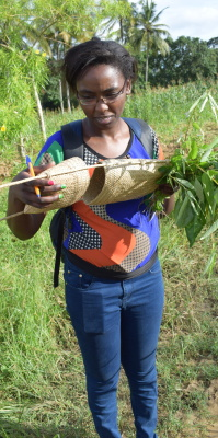 Fiona Njagi carrying a Rabai bag woven with palm leaves