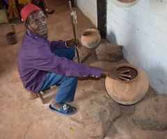 Mr Mwatsuma showing some of the traditional Mijikenda kitchen items