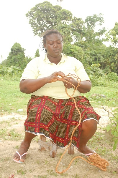 Urhobo woman weaving a fibre rope (Photo: Julius Ivwoba Arerierian)
