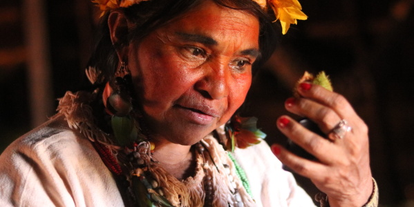 Female Shaman Dona Ivone applies traditional face painting in preparation for Jerosy Puku ritual (Photo: Jaqueline Gonçalvez Porto)
